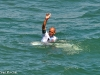 Kelly Slater salutes the fans on the Huntington Beach Pier